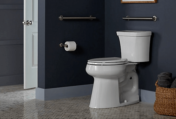 Kohler Highline Tall toilet in blue bathroom | Popular Kohler toilets | Weinstein Collegeville