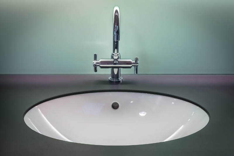 Black and white vanity top with stainless steel faucet | how to choose a faucet | Weinstein Collegeville