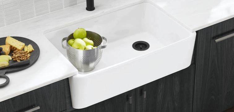 Kohler Ironridge farmhouse sink in kitchen with bowl of fruit   Farmhouse Kitchen Sink   Weinstein Collegeville