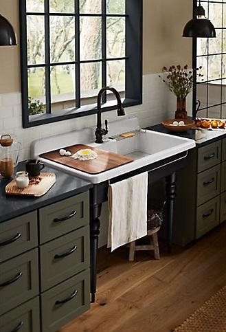 Kitchen with cutting board over sink   2021 kitchen remodeling   Weinstein Collegeville